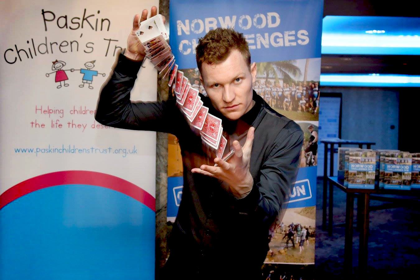 Street Magician Liam Walsh performing close up magic at Norwood Charity Boxing Night in London