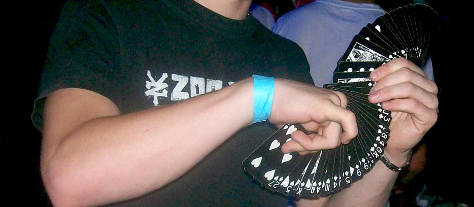 Street Magician Liam Walsh performing close up magic at Rain Dance Rave in London